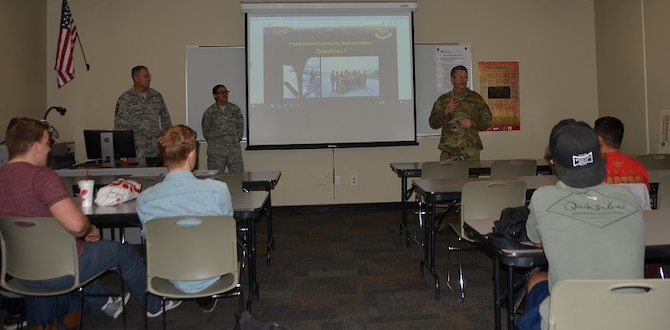 Chief Master Sgt. David Meehan, 161st Air Refueling Wing aircraft maintenance superintendent, provides the Wing's mission brief to pilot students at Chandler-Gilbert Community Jan. 15, increasing awareness about the Arizona Air National Guard and the process to join the Air Guard. Meehan's presentation generated interest among the prospective recruits, while solidifying a community-partnership with the learning institution. (U.S. Air National Guard photo by 1st Lt .Tinashe Machona)