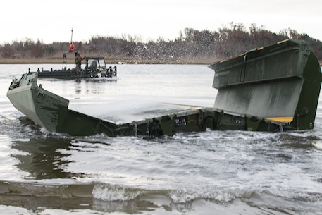 U.S. Marines with Bridge Company, 8th Engineer Support Battalion, 2nd Marine Logistics Group, launch a section of an Improved Ribbon Bridge during a company level field exercise at Camp Lejeune, North Carolina, Jan. 15, 2019.  Bridge Company conducted the exercise to sustain mission essential training and standards, and rehearse alternative methods of employing equipment to support infantry units. (U.S. Marine Corps photo by Lance Cpl. Damion Hatch Jr)