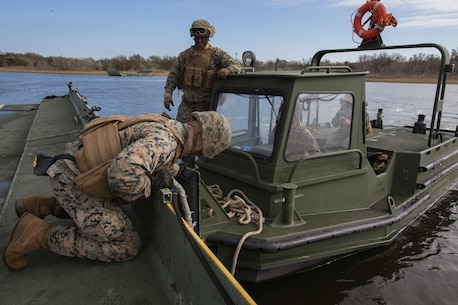 U.S. Marines with Bridge Company, 8th Engineer Support Battalion, 2nd Marine Logistics Group, construct an Improved Ribbon Bridge during a company level field exercise at Camp Lejeune, North Carolina, Jan. 15, 2019.  Bridge Company conducted the exercise to sustain mission essential training and standards, and rehearse alternative methods of employing equipment to support infantry units. (U.S. Marine Corps photo by Lance Cpl. Damion Hatch Jr)