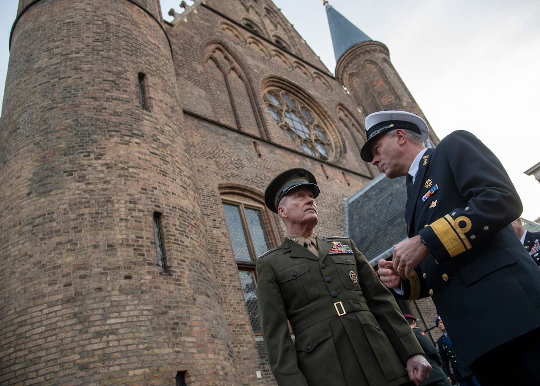Marine Corps Gen. Joe Dunford, chairman of the Joint Chiefs of Staff, speaks with his Dutch counterpart, Navy Adm. Rob Bauer, the Netherlands' chief of defense, at the Binnenhof in The Hague, Netherlands.
