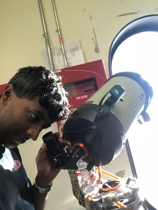 Capt. Michael Nayak, an AFRL scientist, tests the ability of the telescope (and the operator) to acquire and track stars during the daytime. This is a very demanding task due to the bright reflections from the ice. (Courtesy photo)