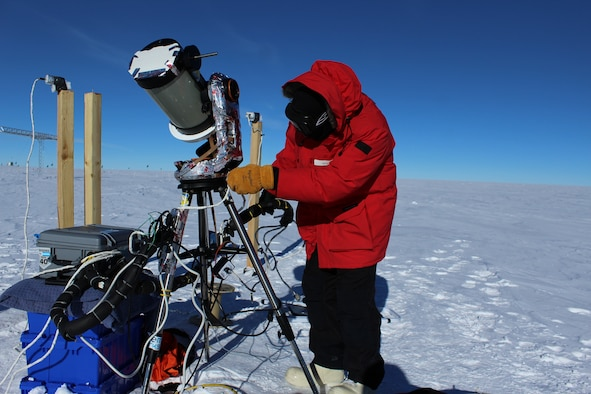 Capt. Michael Nayak, an AFRL scientist, sets up the optical telescope in the harsh environment of the South Pole. (Courtesy photo)