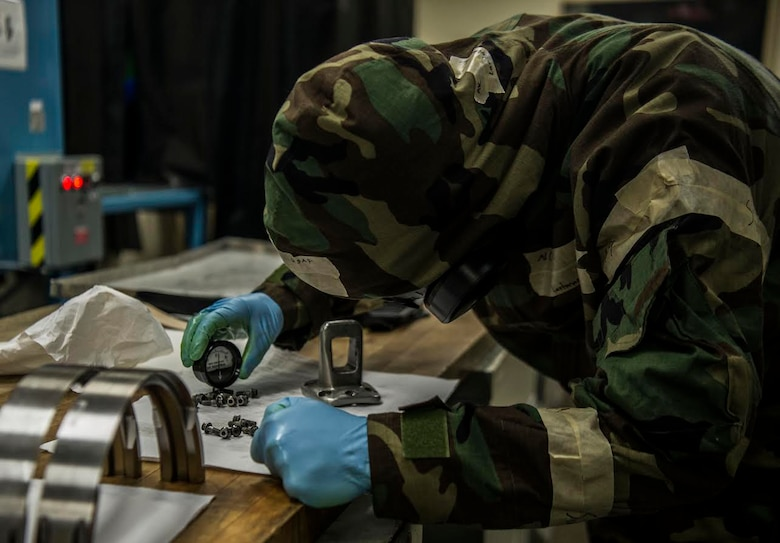 U.S. Air Force Airman 1st Class Colin Lanterman, 20th Equipment Maintenance Squadron non-destructive inspection apprentice, checks parts to ensure a magnetic field was completely removed at Shaw Air Force Base, S.C., Jan. 15, 2019.
