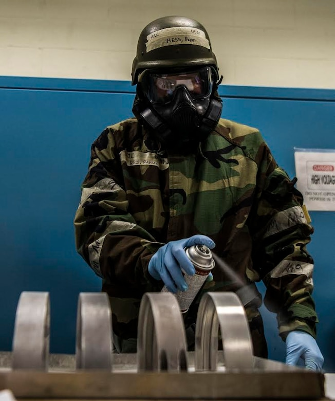 U.S. Air Force Airman 1st Class Ryan Hess, 20th Equipment Maintenance Squadron (EMS) non-destructive inspection apprentice, sprays down metal parts to prepare them for inspection at Shaw Air Force Base, S.C., Jan. 15, 2019.