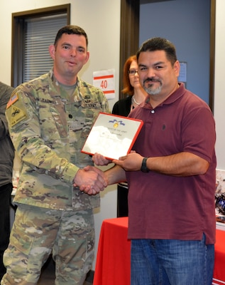 Albuquerque District Commander Lt. Col. Larry Caswell recognizes Joseph Hernandez as the District Office's Employee of the Year, Dec. 12, 2018.