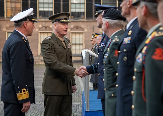Marine Corps Gen. Joe Dunford, chairman of the Joint Chiefs of Staff, participates in an arrival ceremony with his counterpart, Dutch Lt. Adm. Rob Bauer, chief of defense of the Armed Forces of the Netherlands, at the Binnenhof in the Hague, Jan. 18, 2019.
