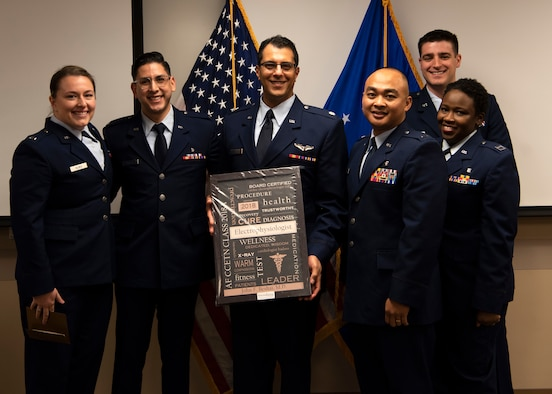 Critical Care and Emergency Trauma Nursing Fellowship Class 18A graduates stand with Lt. Col. John Beshai, 944th Aeromedical Staging Squadron flight surgeon and guest speaker, after their graduation ceremony at Honor Health Scottsdale Healthcare Osborn Medical Center in Scottsdale, Ariz., Jan. 17, 2019.