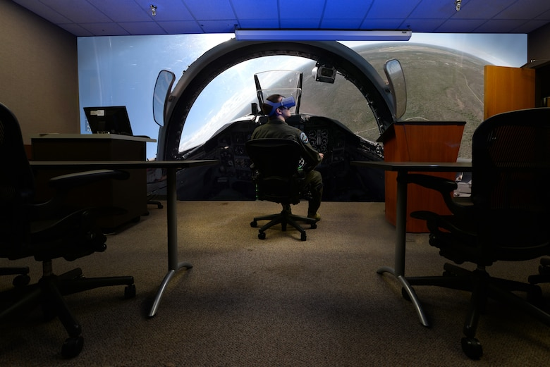 A student pilot assigned to the 87th Flying Training Squadron, immerses himself into a prototype virtual reality training solution at Laughlin Air Force Base, Texas, Jan. 16, 2019. Instructor pilots from the 87th Flying Training Squadron, like Capt. Jason Dark, are looking to boost traditional classroom lessons on aircraft maneuvers and provide a better course for students with the help of virtual reality. (U.S. Air Force illustration by Senior Airman Benjamin N. Valmoja)