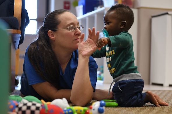 Kristina Arnold, a 28th Force Support Squadron child and youth program assistant, plays with Ryan A. Nyantakyi, the son of Senior Airman Bernice Asiedu, a 28th Bomb Wing financial technician, at the McRaven Child Development Center on Ellsworth Air Force Base, S.D., Dec. 6, 2018. The 28th FSS recently received the results from the November 2018 childcare survey. The results received a total of 208 inputs, and over half of respondents said they use some form of childcare. (U.S. Air Force photo by Airman 1st Class Christina Bennett)