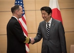 Chief of Naval Operations (CNO) Adm. John Richardson, left, met with Japanese Prime Minister Shinzo Abe to further strengthen military ties between the United States and Japan. Richardson reaffirmed the U.S. Navy's commitment to maintaining security cooperation with the Japan Maritime Self-Defense Force (JMSDF) and broadening and strengthening global maritime awareness and access with Japan and the region. The U.S. Navy and the JMSDF routinely conduct combined maritime exercises and operate together to promote peace and security in the Indo-Pacific region.