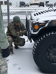 New York Air National Guard Master Sgt. Peyton Knippel, assigned to the 174th Attack Wing, prepares a humvee for a snow storm response missoion as  Hancock Field Air National Guard Base , Syracuse, N.Y. on Jan. 18, 2019. The New York National Guard alerted 450 Airmen and Soldiers for possible missions as a major snow storm approached New York.