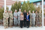 Left to right, Maj. Patrick Arizmendi, the deputy director of the Nevada Guard State Partnership Program; Lt. Col. Randy Lau, director of the SPP; Capt. David Tole, security cooperation planner of the SPP; Col. John Week, director of the Nevada joint staff; Brig Gen. William Burks, Nevada adjutant general; Dr. Saira Yamin, a professor at the Daniel K. Inouye Asia-Pacific Center for Security Studies; retired Ambassador Steven McGann, former U.S. ambassador to Fiji; Maj. Qiana Harder, a U.S. Army fellow from APCSS; Maj. Scott Katherman, judge advocate assigned to the 17th Sustainment Brigade; Maj. Dana Grigg, the Nevada Guard's Women, Peace and Security team lead; Capt. Siulolo Tapueluelu of His Majesty's Armed Forces from Tonga, and Sgt. 1st Class Tera Eilers, a WPS subject matter expert from the Oregon National Guard's SPP team, take a break for a photo in front of the Nevada National Guard's Office of  the Adjutant General in Carson City, Jan. 8, 2019.
