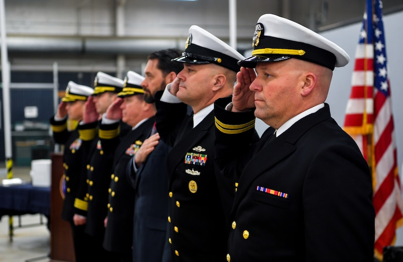 The official party salutes the colors during the National Anthem Jan. 16, 2018, at Joint Base Charleston, S.C.