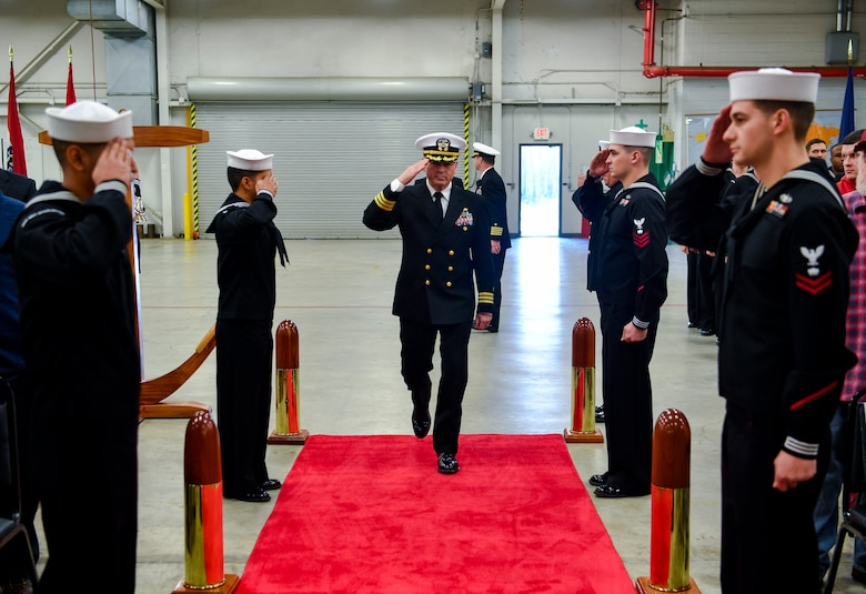 Cmdr. William Edenbeck, Navy Munitions Command Atlantic Unit Charleston commanding officer, salutes the Sideboys before a change of command ceremony Jan. 16, 2018, at Joint Base Charleston, S.C.