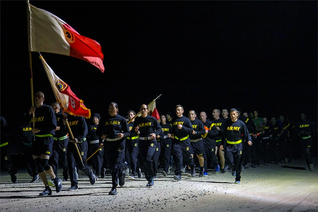 Soldiers run at night.