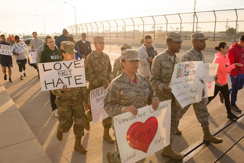 Airmen assigned to the 56th Fighter Wing participate in a Martin Luther King Jr. Day remembrance march at Luke Air Force Base, Ariz., Jan. 18, 2019. Martin Luther King Jr. has been celebrated the third Monday in January as a federal holiday since 1986. (U.S. Air Force photo by Senior Airman Caleb Worpel)
