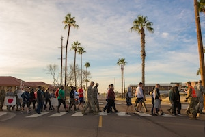Airmen assigned to the 56th Fighter Wing participate in a Martin Luther King Jr. Day remembrance march at Luke Air Force Base, Ariz., Jan. 18, 2019. The march was a re-enactment of three protest marches which took place during the Civil Rights Movement in Selma, Alabama, 1965. (U.S. Air Force photo by Senior Airman Caleb Worpel)