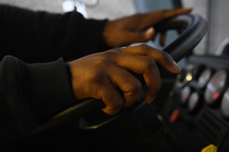 Jonathan Matthews, a firefighter assigned to the 97th AMW Fire Department, grips the steering wheel on a driving simulator Jan 15., 2019, at Altus Air Force Base, Okla. The simulator is used to help train vehicle operations while outdoor conditions are not ideal. (U.S. Air Force photo by Airman 1st Class Jeremy Wentworth)