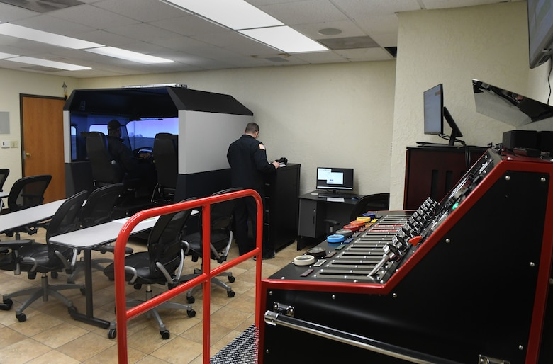 A driving simulator and a fire truck pump simulator are stationed inside of the 97th Air Mobility Wing Fire Department, Jan. 15, 2019, at Altus Air Force Base, Okla. Both simulators are coordinated together to create mission simulations that follow a narrative starting from driving to a scene and ending with fighting the fire. (U.S. Air Force photo by Airman 1st Class Jeremy Wentworth)