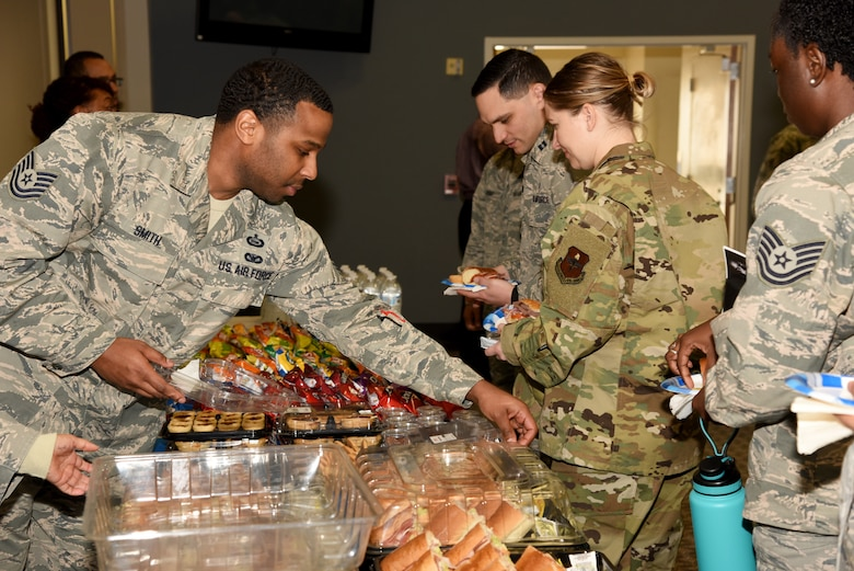 U.S. Air Force Tech. Sgt. Eugene Smith III, 315th Training Squadron instructor, prepares food while volunteering with the 17th Training Wing Equal Opportunity at the Dr. Martin Luther King Jr. Day luncheon at the Event Center on Goodfellow Air Force Base, Texas, Jan. 17, 2019.  EO hosted the event with assistance from the local community. (U.S. Air Force Photo by Airman 1st Class Abbey Rieves/Released)