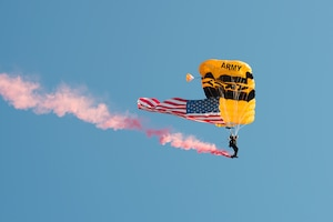 The U.S. Army Golden Knight Parachute Team performed during the Accessions Reflagging ceremony at Fort Knox, Kentucky. (US Army Photo by Charles Leffler)