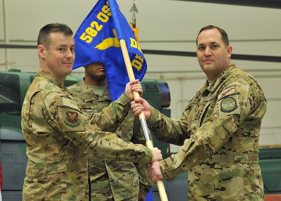 Maj. Cas Smith, right, accepts command of the 582nd Operations Support Squadron, Detachment 4, from Lt. Col. Todd Springer, 582nd OSS commander, Jan. 18, 2019, at Malmstrom AFB, Mont. (U.S. Air Force photo by John Turner)