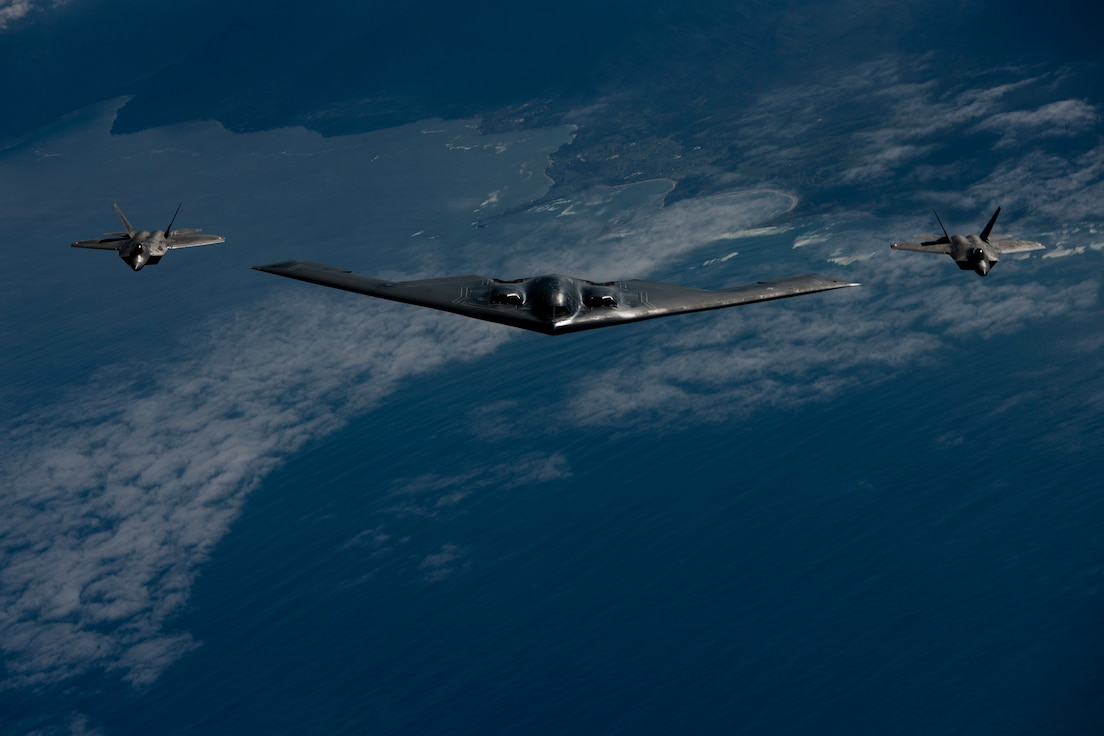 B-2 join F-22 Raptors during training mission