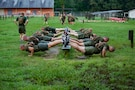 U.S. Marine officer candidates with Officer Candidate School (OCS), participate in an upper body strength training course on Marine Corps Base Quantico, Va