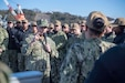 YOKOSUKA, Japan (Jan. 18, 2019) Master Chief Petty Officer of the Navy (MCPON) Russell Smith answers a question about qualifications from a Sailor, assigned to the guided-missile cruiser USS Antietam (CG 54), in Yokosuka, Japan during an all hands call. MCPON is the highest enlisted leader in the Navy and was sent to collect Sailors' and enlisted leaders' insights on their challenges in the 7th Fleet to maintain a war fighting readiness. This is the MCPON's first visit to Commander, Fleet Activities Yokosuka as the U.S. Navy's 15th Master Chief Petty Officer of the Navy.