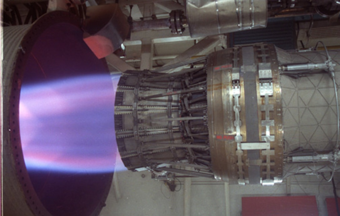 A F100-PW-229 ram engine, which powers the F-15 Eagle and F-16 Fighting Falcon, undergoes accelerated mission testing in the in J-1 engine test cell at Arnold Air Force Base. (U.S. Air Force photo)