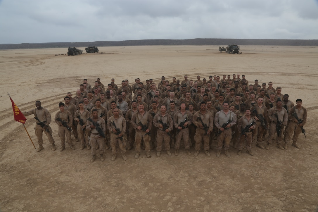 U.S. Marines with Bravo Battery, Battalion Landing Team 3/1, 13th Marine Expeditionary Unit, pose for a photo in Djibouti during Theater Amphibious Combat Rehearsal, September 13, 2018.
