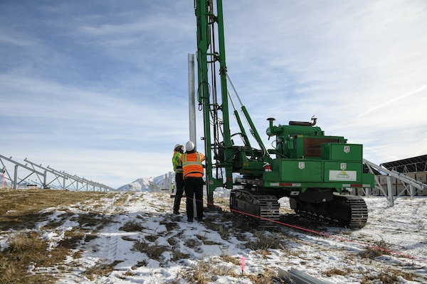 Posts are driven into the ground by a crew installing a new solar array at Hill Air Force Base, Utah, Dec. 14, 2018.