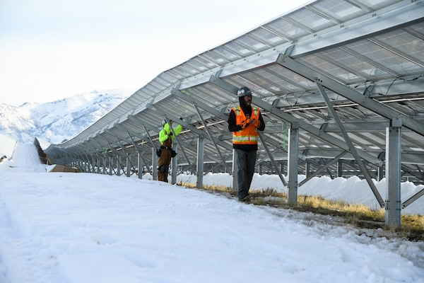 Bobby Southerland, right, and Jon Wall install electrical wiring clips onto the new solar array being installed at Hill Air Force Base, Utah, Jan. 9, 2018.