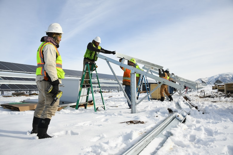 A construction crew works on the new solar array being installed at Hill Air Force Base, Utah, Jan. 9, 2018.