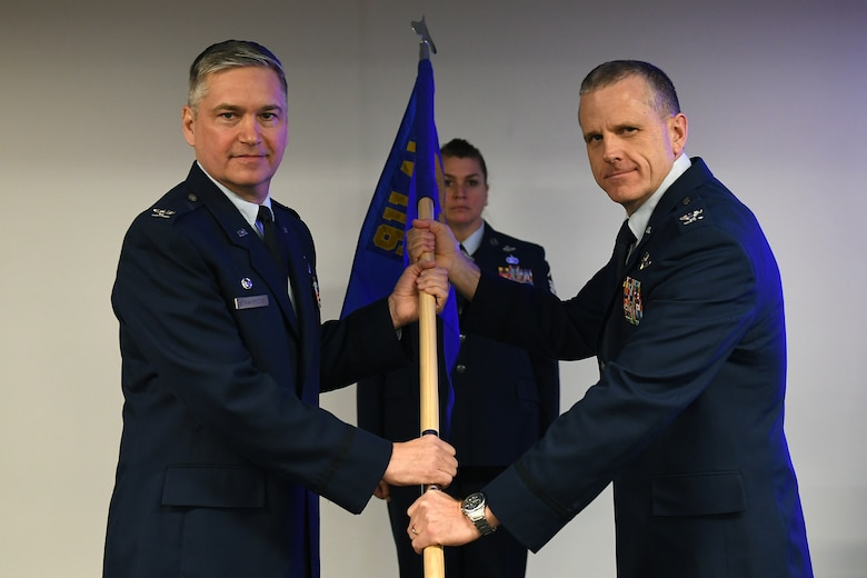 Col. Gregory D. Buchanan, commander of the 911th Operations Group, accepts the guide-on from 911th Airlift Wing Commander Col. Douglas N. Strawbridge during an assumption of command ceremony at the Pittsburgh International Airport Air Reserve Station, Pennsylvania, Jan. 6, 2019. Buchanan assumed command after having served a total of over two years as the interim 911th OG commander during various deployments and contingencies. (U.S. Air Force photo by Tech. Sgt. Marjorie A. Schurr)