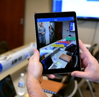 A demonstrator shows how augmented reality can be used to view floating dialogue boxes for individual parts of a mock missile during a demonstration Jan. 8, 2019, at Joint Base Langley-Eustis, Virginia. Augmented reality is one way Airmen could use advanced technology to enhance their training in the field.