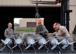 56th Equipment Maintenance Squadron munition Airmen load GBU-12 Paveway II's onto a bomb pad at Luke Air Force, Ariz., Jan. 15, 2019.