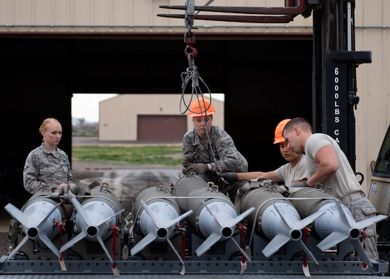 56th Equipment Maintenance Squadron munition Airmen load GBU-12 Paveway II's onto a bomb pad at Luke Air Force, Ariz., Jan. 15, 2019.