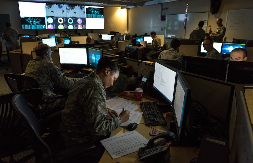 Cyber warfare operators serving with 175th Cyberspace Operations Group of Maryland Air National Guard monitor cyber attacks on operations floor of 275th Cyber Operations Squadron known as Hunter's Den, December 2, 2017 (U.S. Air Force/J.M. Eddins, Jr.)