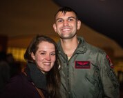 After returning from a deployment, Capt. Zach Petzold, 96th Bomb Squadron electronic warfare officer, and his wife pose for a photo at Barksdale Air Force Base, La., Jan. 16, 2019. Petzold and his team deployed to Andersen Air Force Base, Guam for six months in support of Continuous Bomber Presence. (U.S. Air Force photo by Airman 1st Class Lillian Miller)