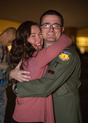 After returning from a deployment, 1st Lt. Tyler Johnson, 96th Bomb Squadron unit deployment manager, poses for a photo with his wife at Barksdale Air Force Base, La., Jan. 16, 2019. While deployed, the squadron flew deterrence missions and conducted a variety of joint missions with the U.S. Navy, U.S. Coast Guard, U.S. Marine Corps, Koku Jieitai (Japan Air Self-Defense Force), Republic of Korea Air Force and the Royal Australian Air Force. (U.S. Air Force photo by Airman 1st Class Lillian Miller)