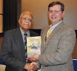 """IMAGE: DAHLGREN, Va. (Jan. 15, 2019) – Chuck Campbell, Naval Surface Warfare Center Dahlgren Division Chief of Staff, presents the Dahlgren history book, """"The Sound of Freedom,"""" to Frank White in appreciation of his keynote speech at the command's Martin Luther King Jr. Observance."""