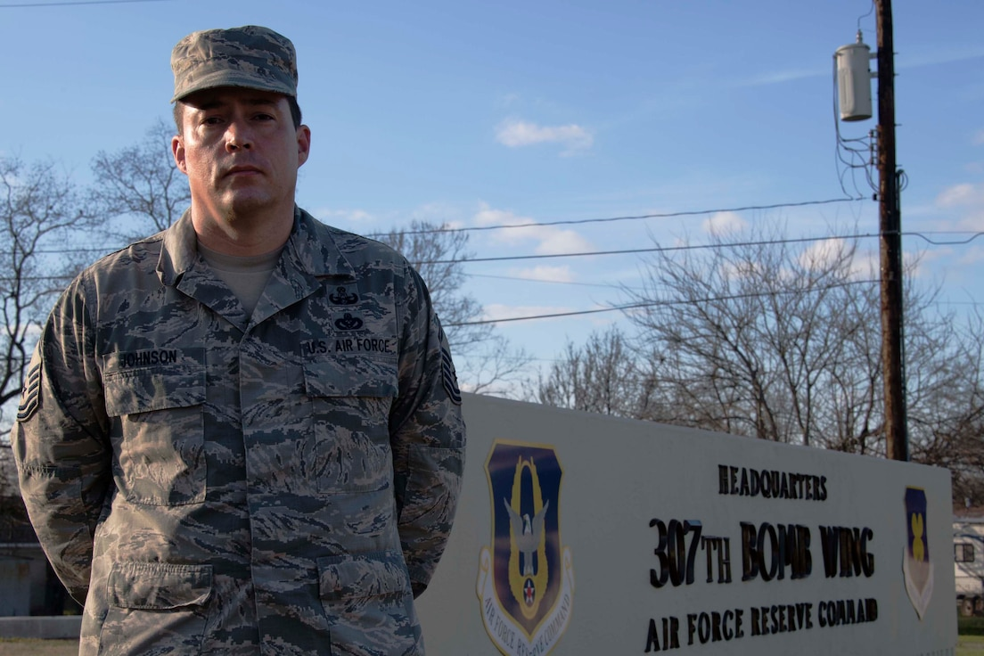 U.S. Air Force Master Sgt. Macord Johnson, 307th Force Support Squadron career assistance advisor, stands in front of the 307th Bomb Wing Headquarters building Jan. 17, 2019.   Johnson plays a vital role in helping Reserve Citizen Airmen of the unit make career decisions and better understand benefits available to them. (U.S. Air Force photo by Master Sgt. Ted Daigle)