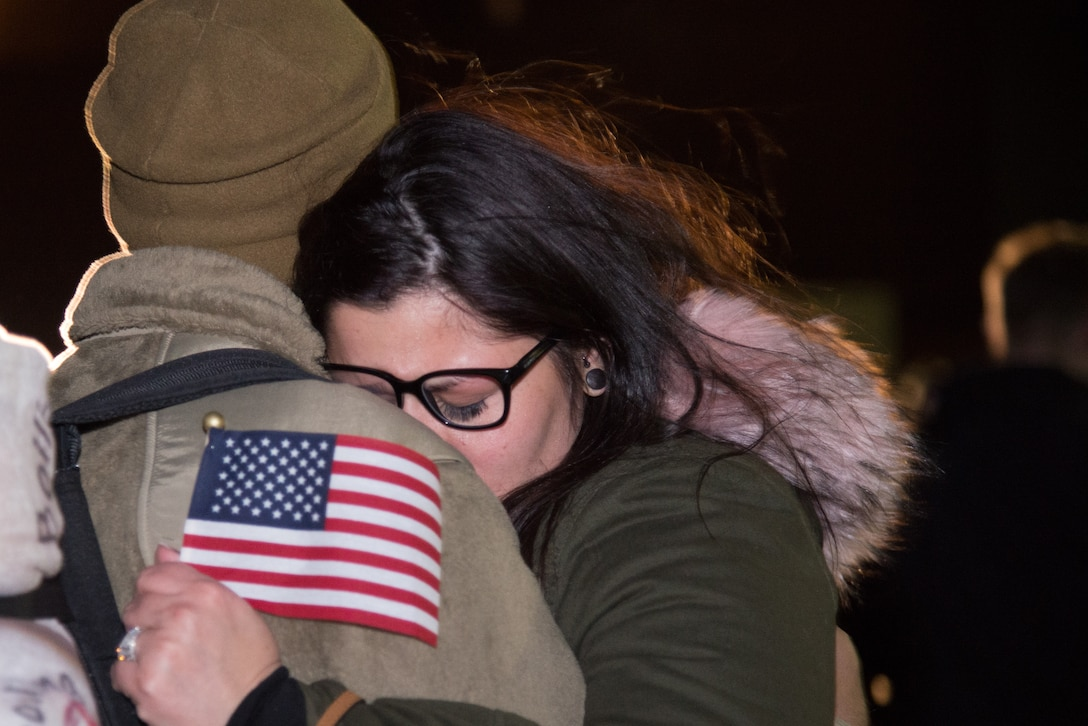 A 302nd Airlift Wing reservist hugs his wife at Peterson Air Force Base, Colorado, after returning from a 4-month deployment Jan. 18, 2019.