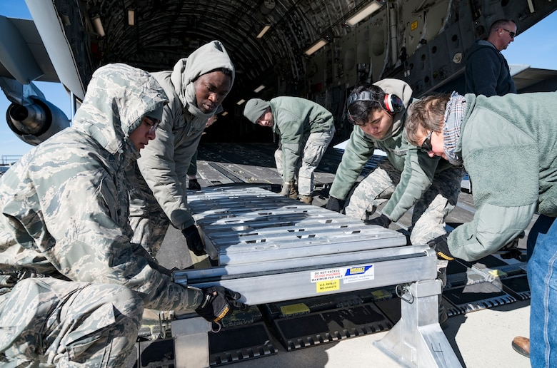 Ramp operations personnel assigned to the 436th Aerial Port Squadron assemble the ramp sections of DOMOPS Airlift Modular Approach Shoring Jan. 11, 2019, at Dover Air Force Base, Del. The modular shoring was used to upload five vehicles belonging to the Delaware National Guard's 31st Civil Support Team, Weapons of Mass Destruction headquartered in Smyrna, Del.