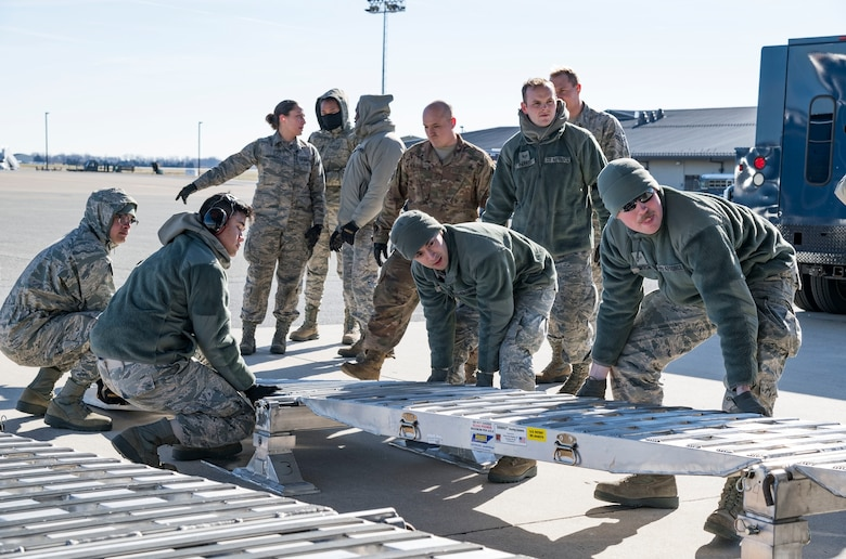 Ramp operations personnel assigned to the 436th Aerial Port Squadron position the DOMOPS Airlift Modular Approach Shoring up to the ramp of a C-17 Globemaster III from the 105th Airlift Wing, Stewart Air National Guard Base, Newburgh, N.Y., Jan. 11, 2019, at Dover Air Force Base, Del. The modular shoring was used to upload five vehicles belonging to the Delaware National Guard's 31st Civil Support Team, Weapons of Mass Destruction headquartered in Smyrna, Del. (U.S. Air Force photo by Roland Balik)