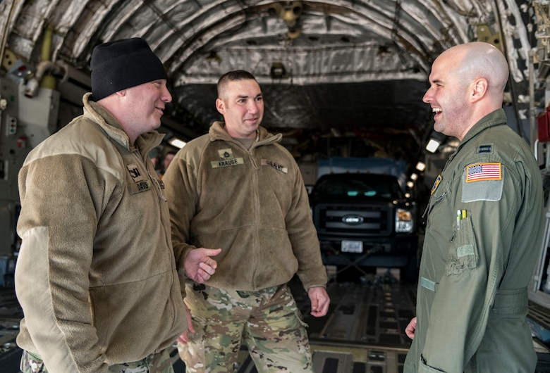 Delaware Army National Guard Capt. Stephen Davis, survey team leader, and Sgt. 1st Class Louis Krause, Chemical, Biological, Radiological and Nuclear NCO in charge, both assigned to the 31st Civil Support Team, Weapons of Mass Destruction headquartered in Smyrna, Del., and Capt. Matt Cullen, 137th Airlift Squadron C-17 pilot, Stewart Air National Guard Base, Newburgh, N.Y., talk on the ramp of a C-17 Globemaster III Jan. 11, 2019, at Dover Air Force Base, Del. Five vehicles and team members were airlifted to Florida to support the Florida National Guard during a large-scale training exercise Jan. 14-18. The 31st CST maintains the capability to mitigate the consequences of any WMD or Nuclear, Biological, and Chemical event, whether natural or man-made. They are experts in WMD effects and NBC defense operations. (U.S. Air Force photo by Roland Balik)