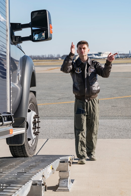 Staff Sgt. Ryan Stanich, 137th Airlift Squadron C-17 loadmaster, Stewart Air National Guard Base, Newburgh, N.Y., marshals a vehicle backing up on the DOMOPS Airlift Modular Approach Shoring Jan. 11, 2019, at Dover Air Force Base, Del. The Delaware National Guard's 31st Civil Support Team, Weapons of Mass Destruction headquartered in Smyrna, Del., were airlifted to Florida by a C-17 assigned to the 105th Airlift Wing, Stewart Air National Guard Base, Newburgh, N.Y., to support a large-scale training exercise Jan. 14-18. The 31st CST maintains the capability to mitigate the consequences of any WMD or Nuclear, Biological, and Chemical event, whether natural or man-made. They are experts in WMD effects and NBC defense operations. (U.S. Air Force photo by Roland Balik)