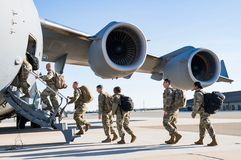 Personnel from the Delaware National Guard's 31st Civil Support Team, Weapons of Mass Destruction headquartered in Smyrna, Del., board a C-17 Globemaster III Jan. 11, 2019, at Dover Air Force Base, Del. Five vehicles and team members were being airlifted to Florida to support the Florida National Guard during a large-scale training exercise Jan. 14-18. The 31st CST maintains the capability to mitigate the consequences of any WMD or Nuclear, Biological, and Chemical event, whether natural or man-made. They are experts in WMD effects and NBC defense operations. The C-17 was from the 105th Airlift Wing, Stewart Air National Guard Base, Newburgh, N.Y., supported by a 137th Airlift Squadron aircrew. (U.S. Air Force photo by Roland Balik)