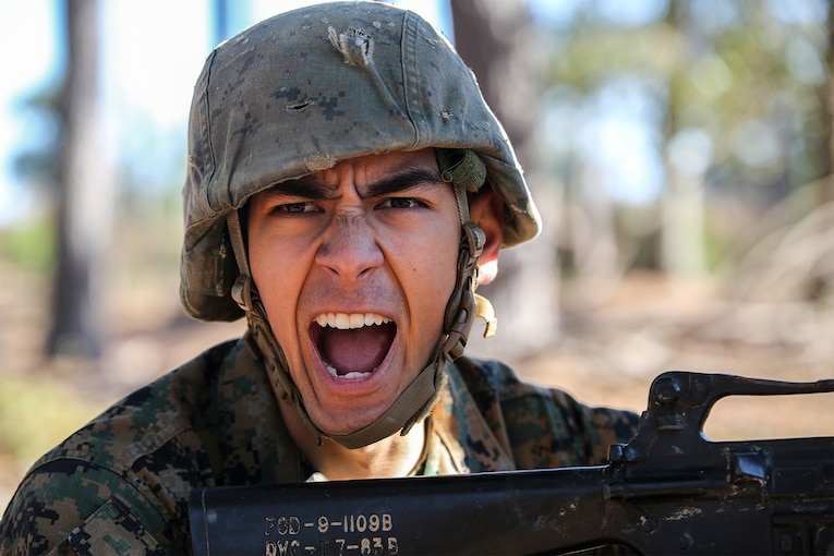 A Marine yells a command to his fire team.
